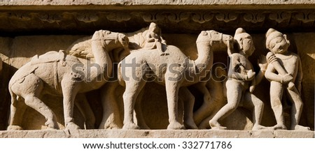 Stone carved erotic bas-relief in Hindu temple in Khajuraho, India. Unesco World Heritage Site