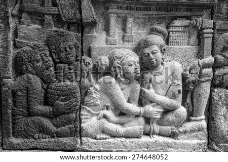 Stone carving on the wall of Borobudur buddhist temple in java,Indonesia. - stock photo
