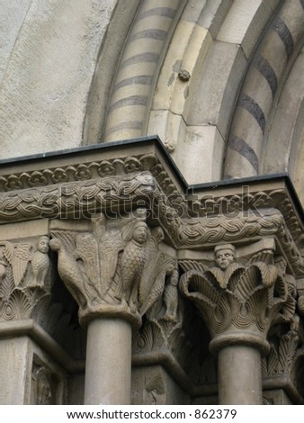 Stone carvings on an archway - stock photo