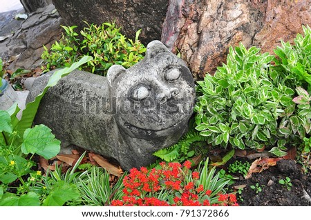 Stone cat statue as garden decoration