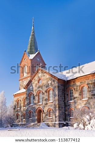 Stone church at Kuopio, Finland in sunny winter day - stock photo