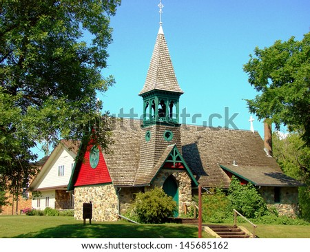 stone church with bell tower - stock photo