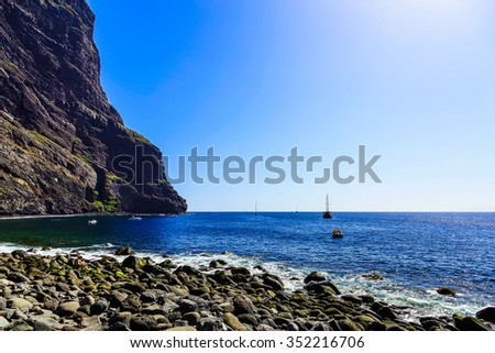 Stone Coast or Shore of Atlantic Ocean with Waves and Sky on Tenerife Island at Day