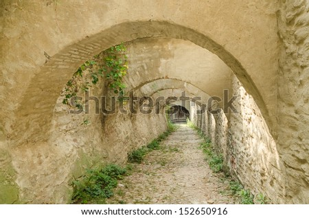 Stone Corridor Road To An Ancient Castle Dungeon - stock photo