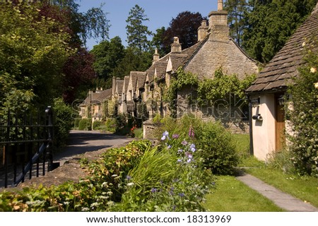 Stone Cottages amongst gardens - stock photo