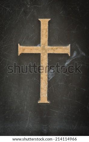 stone cross on black marble - stock photo