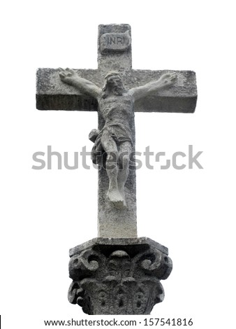 Stone cross with Christ crucified located on the Road To Santiago - stock photo