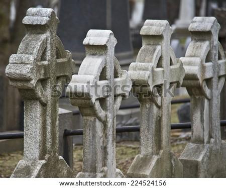 stone crosses on the cemetery - stock photo