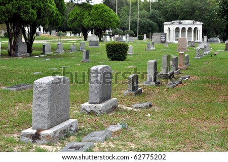 Stone crypts at a cemetery - stock photo