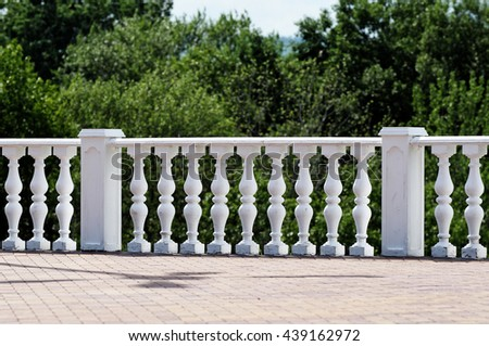 Stone decorative railings in the old Park - stock photo