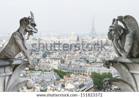 Stone demons gargoyle and chimera with Paris city on background. View from Notre Dame de Paris - stock photo