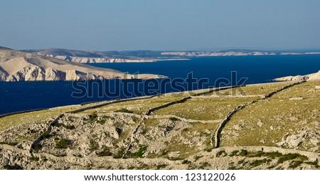 Stone desert landscape and sea -  islands of Croatia (Krk, Grgur, Prvic, Rab) - stock photo