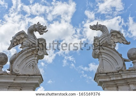 stone dragon statue on the blue sky background