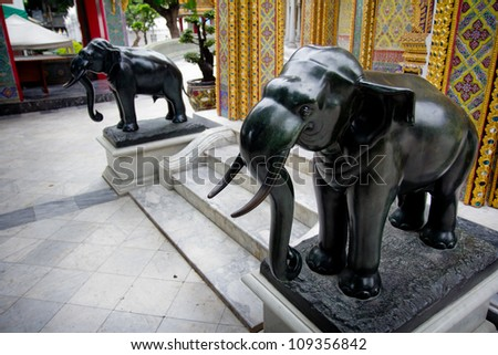 Stone Elephant standing in front of the gate in the temple. Bangkok, Thailand