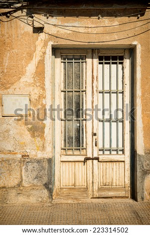 Stone facade and an old wooden door
