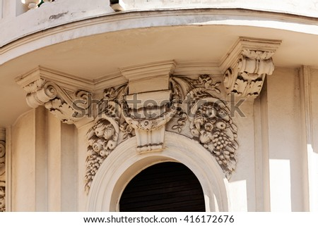 stone facade on classical building with ornaments and sculptures
