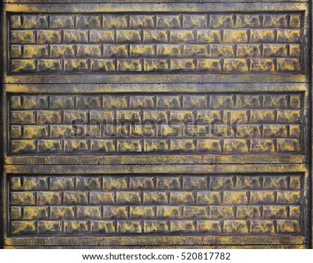 Stone fence texture - building feature. Texture of concrete fence with relief and texture like a golden stone wall