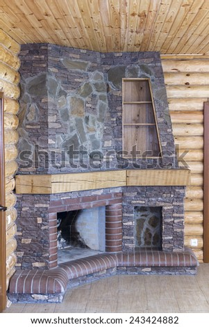Stone fireplace. - stock photo