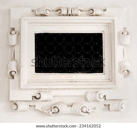 Stone frame with an ornament. Converted modeling for the fireplace. - stock photo