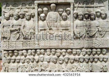 Stone frieze sculpture of the Byzantine Emperor Theodosius showing him in a crowd watching a race at the hippodrome in Istanbul, Turkey. - stock photo
