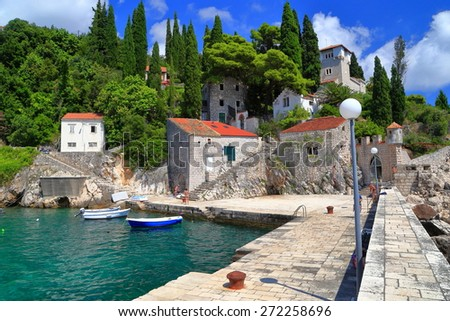 Stone harbor protected by an old pier near Adriatic sea, Trsteno, Croatia - stock photo