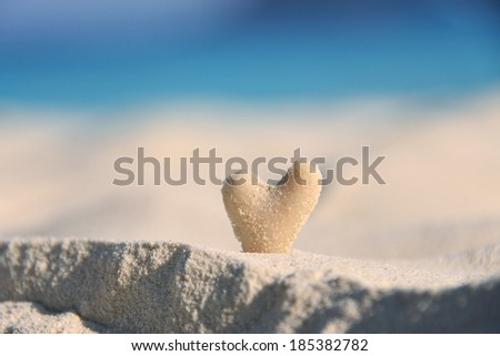 stone heart on the sand - stock photo