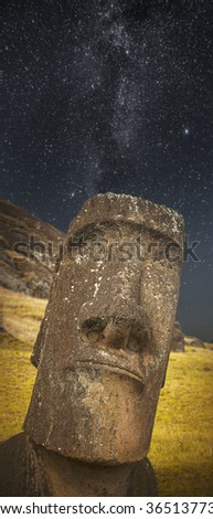 stone idol looks to the top space. - stock photo