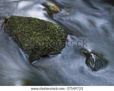 Stone in a pitch shot with long exposure time. - stock photo