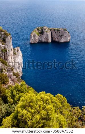 Stone islands and cliff on Capri coast - Italy - stock photo