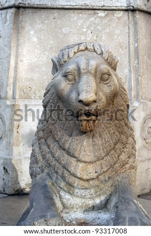 Stone lion statue. Lion statue made of stone.