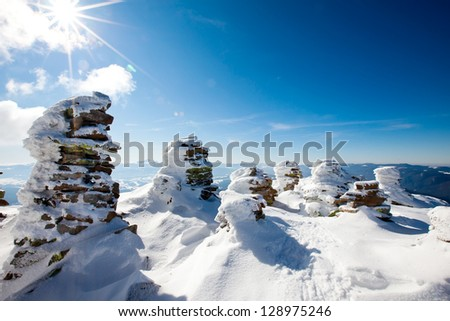 Stone marks on the top of the mountain in wintertime - stock photo
