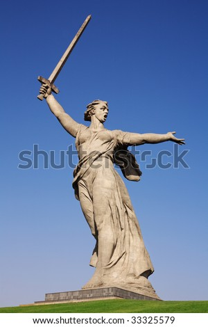 """Stone monument """"The Motherland Calls"""" standing against blue sky - stock photo"""