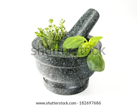 Stone mortar and pestle, exotic cooking tool  - stock photo