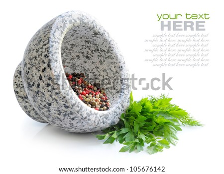 Stone mortar with mixture of peppers and greenery of parsley on white background
