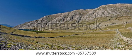 Stone mountain desert & Sea in Vela Luka, Krk, Croatia - stock photo