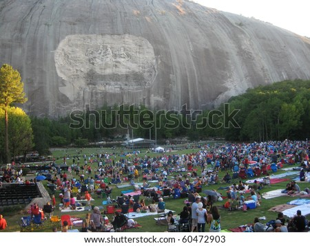 STONE MOUNTAIN, GA - SEPT 5: Labor Day weekend crowds gather for a laser light show at Stone Mountain, GA on Sep. 5, 2010. The mountain features the largest bas-relief sculpture in the world.