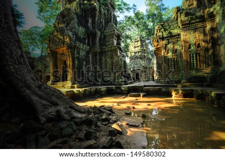 Stone murals and sculptures in Angkor wat, Cambodia the impressive temples near siem reap build by the red khmer civilisation. - stock photo