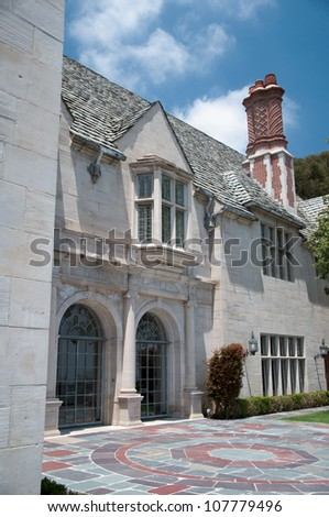 Stone old house with beautiful sunny garden - stock photo