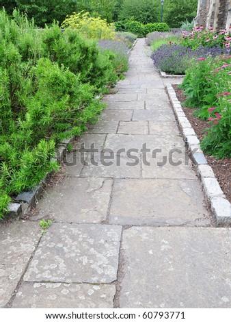 Stone Path through a Verdant Garden - stock photo
