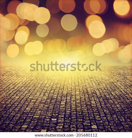 Stone pathway and abstract bokeh lights in grunge style. - stock photo