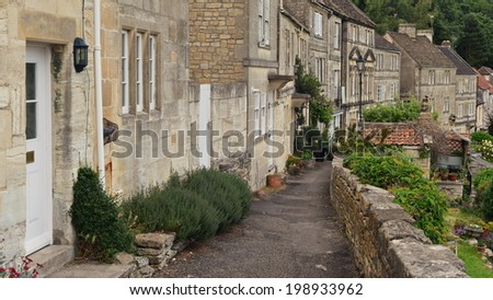 Stone Pathway and Old Terraced Cottage Houses in a Typical English Town - Namely Bradford on Avon in Wiltshire England - stock photo