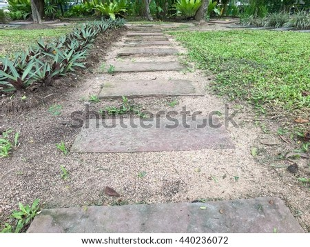 Stone Pathway in a Green Park - stock photo
