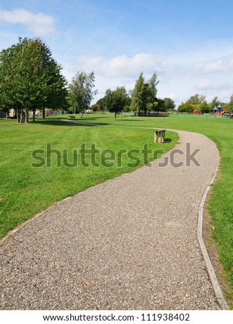 Stone Pathway in a Lush Green Park - stock photo
