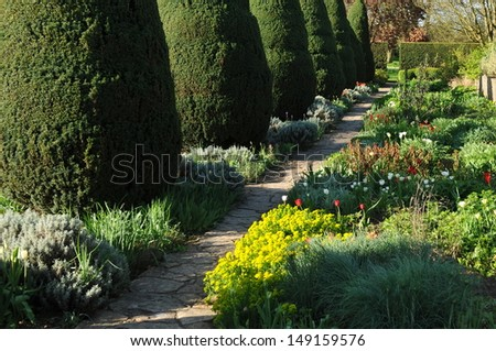 Stone Pathway in a Tranquil Garden - stock photo