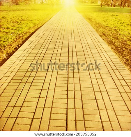 Stone pathway in the park at sunset.Grunge and retro style. - stock photo