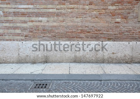 Stone pavement and the wall in the background - stock photo