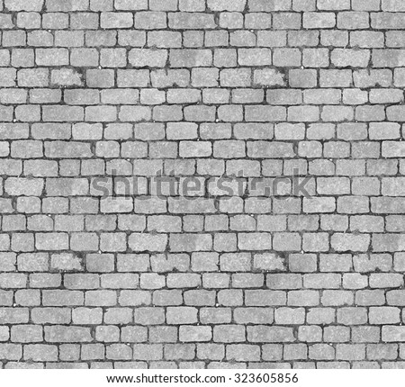 Stone pavement texture. Granite cobblestoned pavement background. Abstract background of old cobblestone pavement close-up. Seamless texture. Perfect tiled on all sides - stock photo