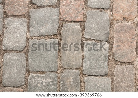 Stone pavement texture. Granite cobblestoned pavement background. Abstract background of old cobblestone pavement close-up. Perfect tiled and close up for all side - stock photo