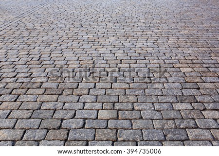 Stone pavement texture in perspective - stock photo