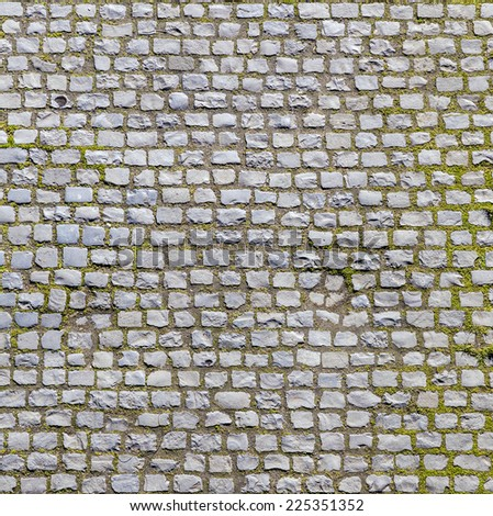 Stone pavement texture of an old road - stock photo